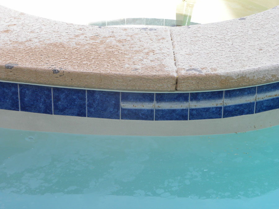 How to remove hard water from pool tiles