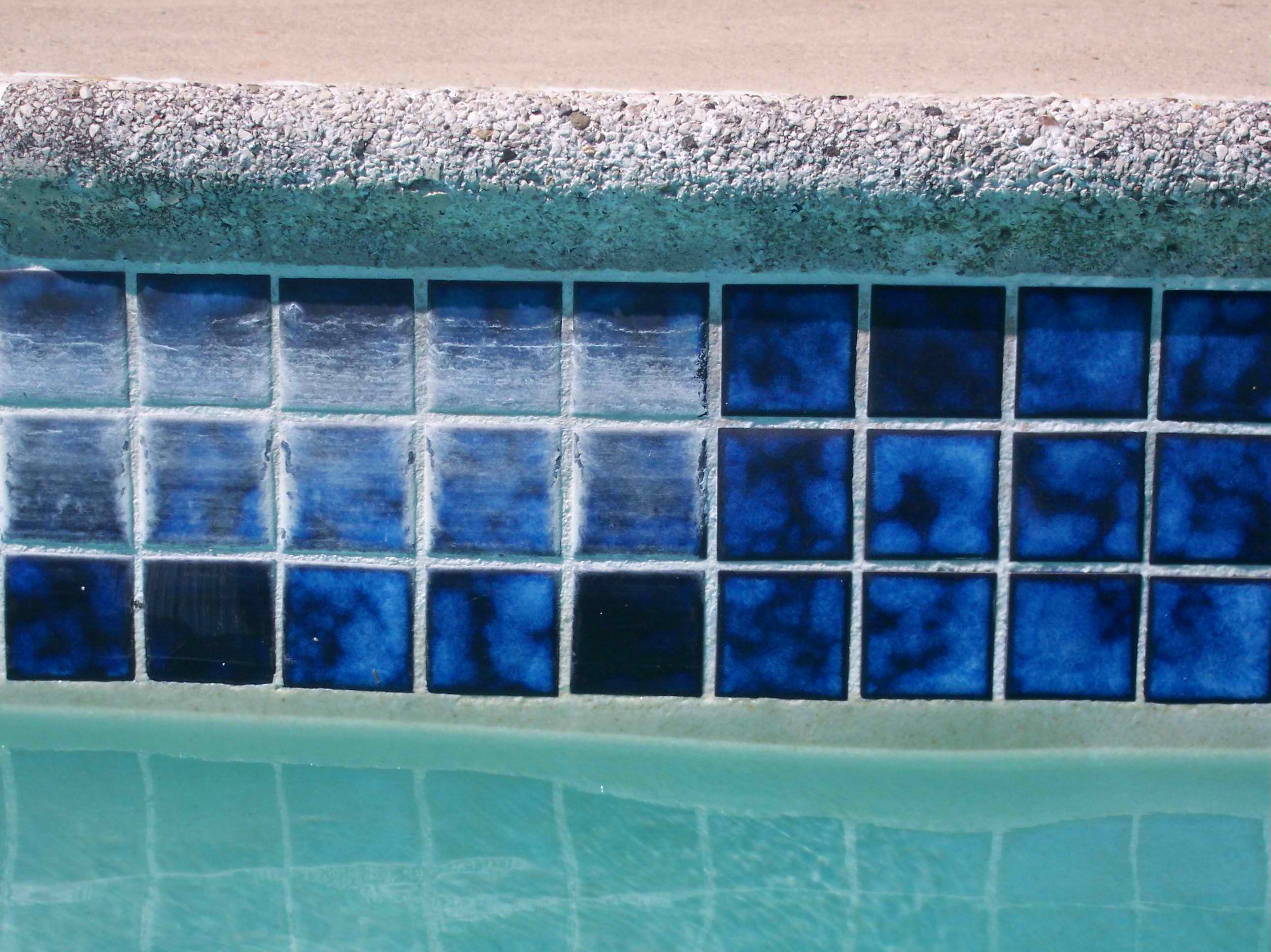 Removing rust stains from anti slip swimming pool tiles in for Swimming pool tile pictures